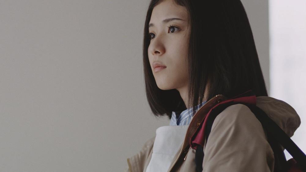 前向きな表情の松岡茉優